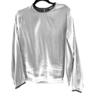 Shimmery silver blouse with black velveteen trim.